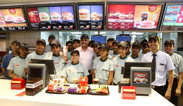 Vikram Bakshi with crews at the newly launched McDonald's largest restaurant in Noida.