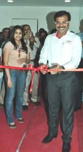 Dr. Vikram Founder of Snap Fitness and Ms. SriLeka Reddy Co founder cutting the ribbon